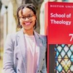 shaunesse' jacobs smiles in front of the BU School of Theology sign